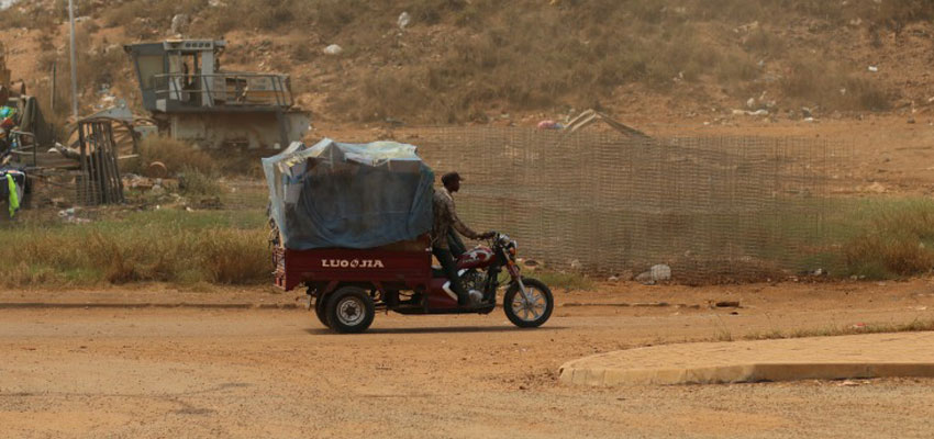 Garbage hauler transports recyclables out from the Kpone landfill