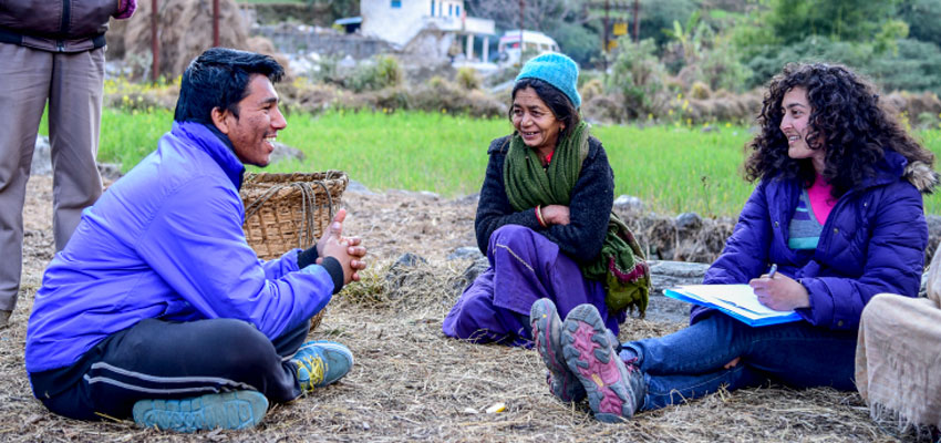 Nupur (right) and her translator Deepak Bhatt (left) interviewing a woman in a village in Bageshwar district of Uttarakhand (center).