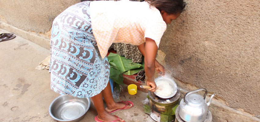 A community member cooking on her Makaa stove just after the team installed a sensor on it.