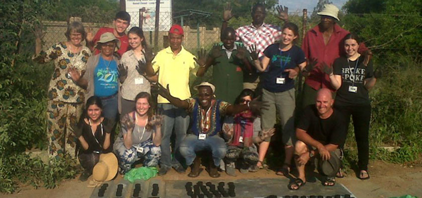 Maddie Hickman (far right, center) with D-Lab founder and co-director Amy Smith (far left), D-Lab: Development students, and community members, Botswana, 2015.