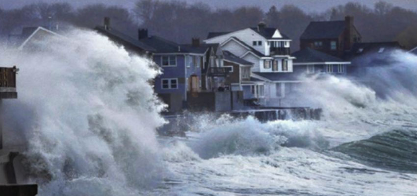 Ocean waves crash over a seawall and into houses along the coast in Scituate, Mass., Thursday, March 7, 2013. Reference: http://www.gazettenet.com/home/4968871-95/storm-thursday-snow-areas