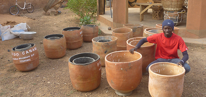 Oumaro Barry with clay pot coolers in Burkina Faso; Photo Credit: Peter Rinker