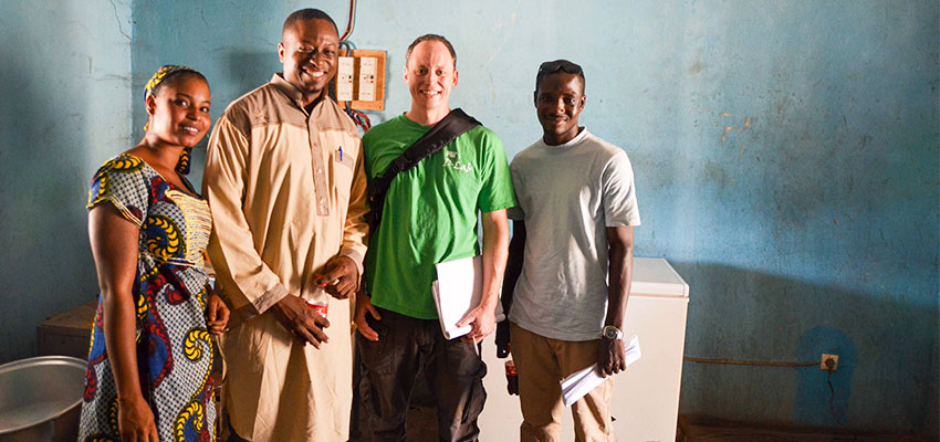 Left to right: A woman who works at a dairy co-operative, Sory Mariko (Mercy Corps), Eric Verploegen (MIt D-Lab), and Abdoulaye Coulibaly (translator).