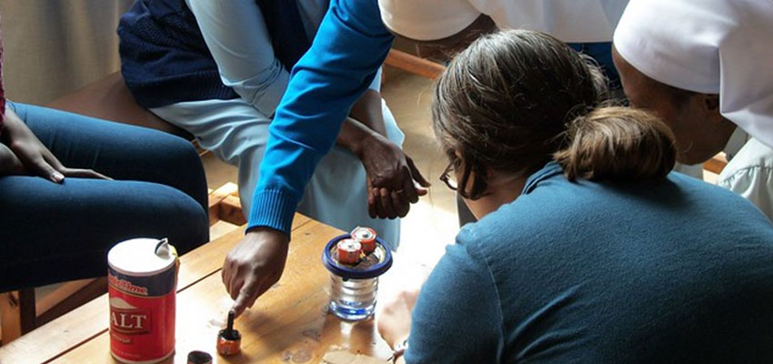 Teaching the Benebikira sisters how to generate chlorine from graphite batteries, salt, and water. January 2011. Photo credit: Nse Umoh