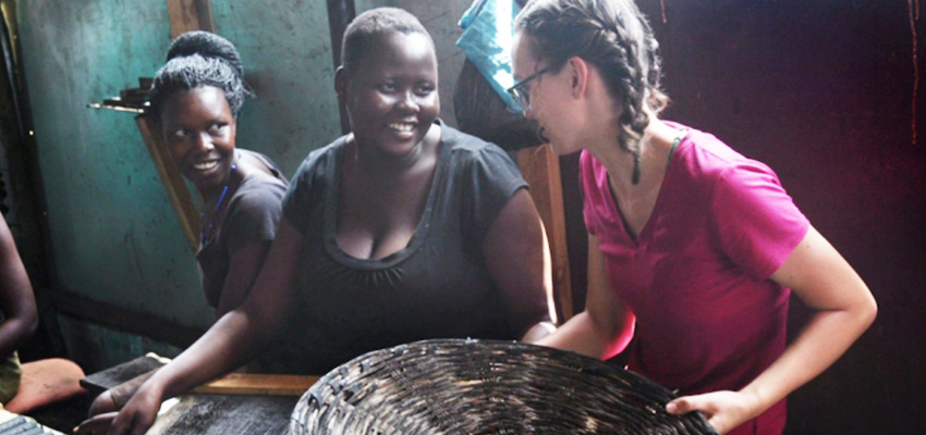 Senior Danielle Gleason (right) speaks with Goretti Ariago (center) and Salume Awiyo (left), employees of Appropriate Energy Saving Technologies, in Soroti, Uganda. Gleason has made two trips to Uganda to help streamline the production of charcoal briquettes which offer a low-smoke alternative for home cooking fuel. Photo: John Freidah