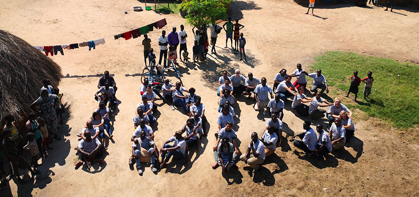 "International Development Design Summit Uganda 2019 participants spell out ""IDDS."" Photo: Debbie Tien"