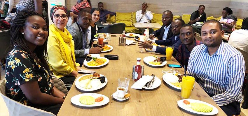 The author's extended social enterprise team at a group lunch, after an exhilarating day of customer conversations.