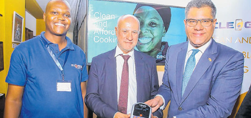 From right are, International Development Secretary United Kingdom, Mr Alok Sharma and   Safaricom Plc Chief Executives officer, Michael Joseph displays Pay-As-You-Go clean gas technology during the acquisition of Kopagas proprietary technology to UK Company during an event held in Nairobi Kenya. Looking on is Mr Andron Mendes inventor of Pay-As-You-Go clean gas technology.