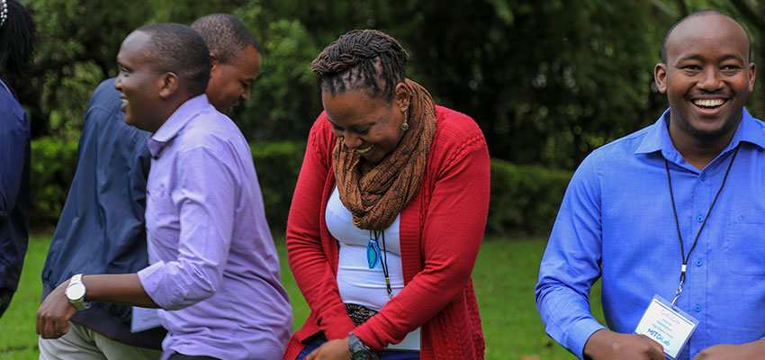 Tackling Challenges to Scale 2019 MIT D-Lab Co-Design Summit participants, Peter Mumo, Noeline Kirabo and Gibson Muriuki share a laugh during morning circle.