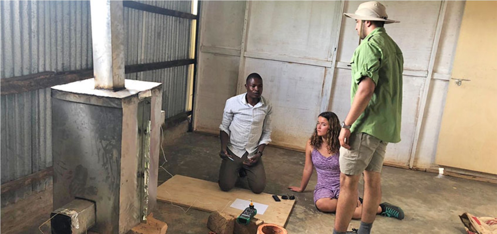 D-Lab students and communit member at TEWDI Uganda testing an indoor biomass dryer. January 2020.