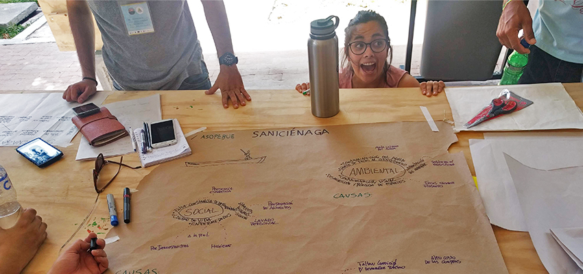 "Team SaniCiénaga's problem framing exercise. Team member Alejandra Villagrán Hernández says that visiting the community before framing the problem allowed her to ""visualize the social dynamics and analyze shared habits."""