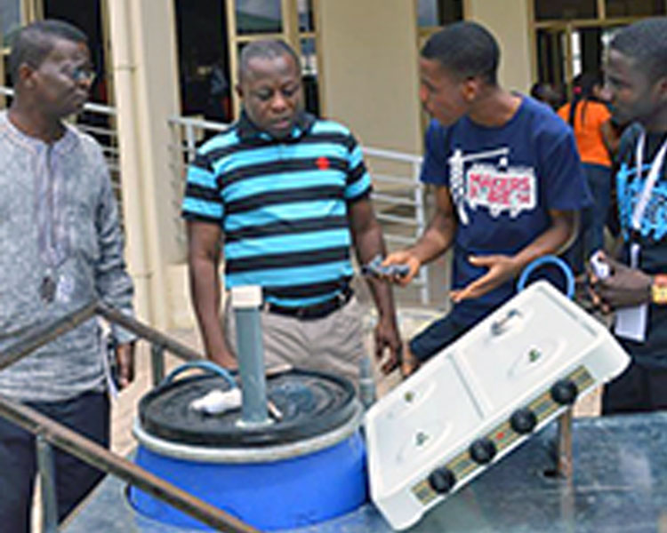 Student participants at the GESA Maker Faire in Accra, Ghana display their prototype.