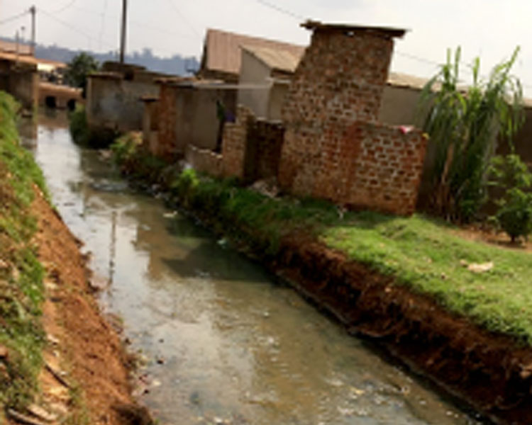 Plastic and chemical waste polluting a stream in an industrial area of Kampala.