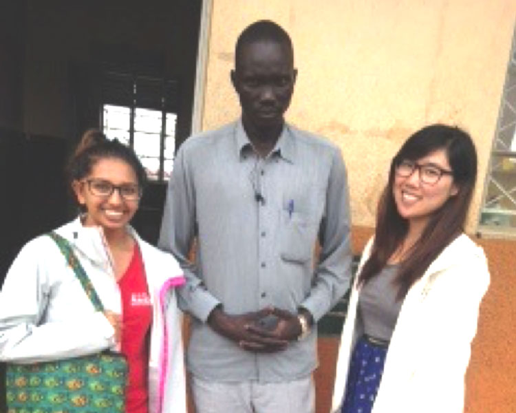 Nisha & Jeannie with Mr. Kut Buol, the head teacher of Ayilo Primary 1A.