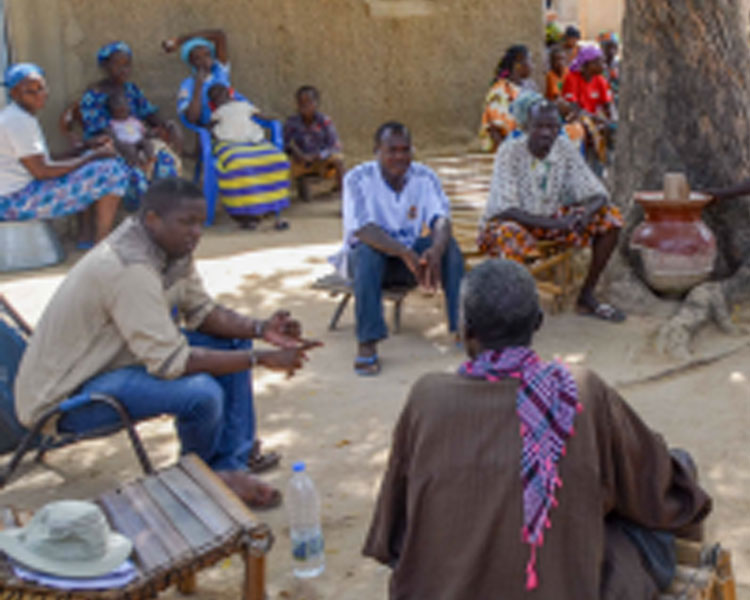 Mercy Corps' Sory Mariko discussing the energy needs with community leaders in the village of Tiby, Mali.