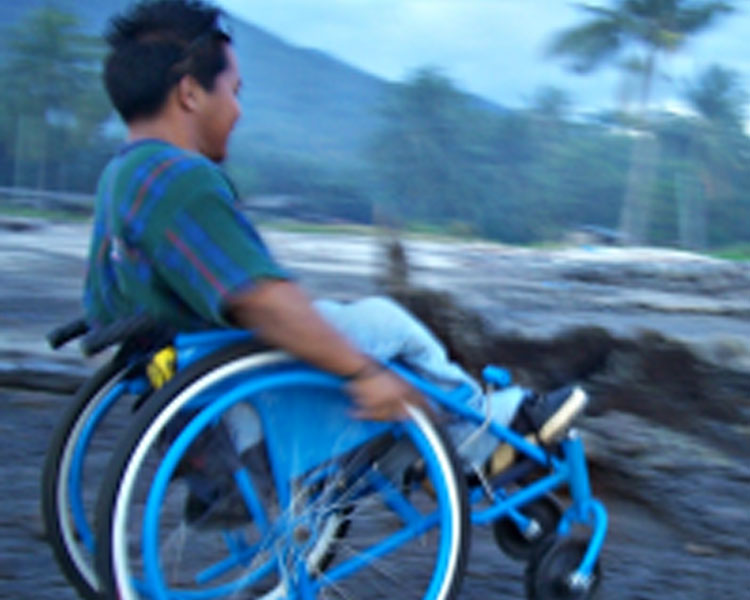 Bryan Cubao, a welder in the southern Philippine island of Mindanao, hits the beach in a chair built locally to his measurements.