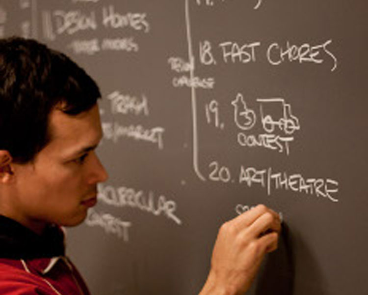 Nathan documenting a brainstorming session. Photo: Victor Grau Serrat. Source: D-Lab Archives.