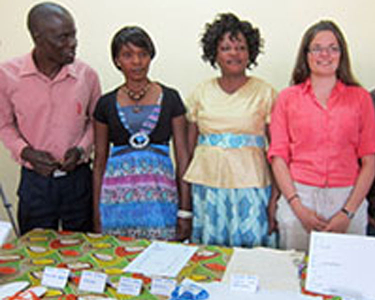 Martin (far left) presents with his menstrual hygiene team and their prototypes at the International Development Design Summit in Zambia.