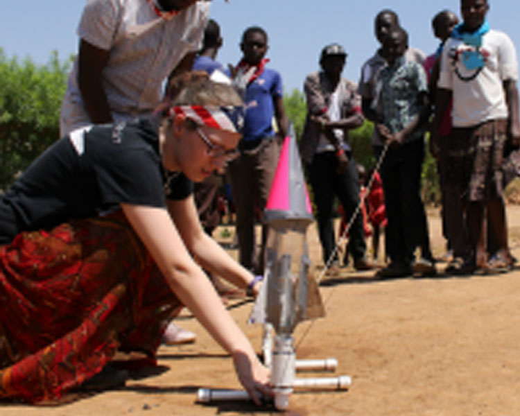 Jim (Makerere Universit) and Maddie Haas prepare a bottle rocket for launch. (Photo: Lauren Bustamente)