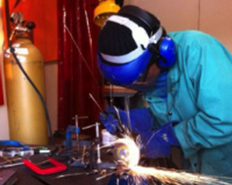 Netia welding in the D-Lab shop.  ​