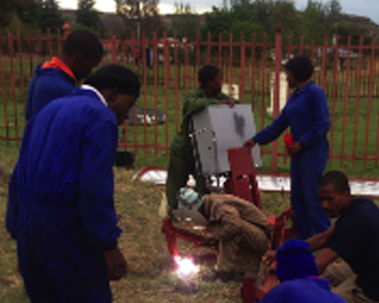 Lesotho team installing a prototype Parabolic Trough Collector (PTC) at the National University of Lesotho in November 2014