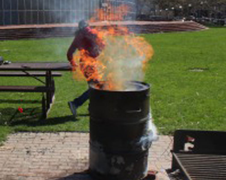 MIT Engineers Without Borders students fire an MIT kiln at Kresge Lawn.