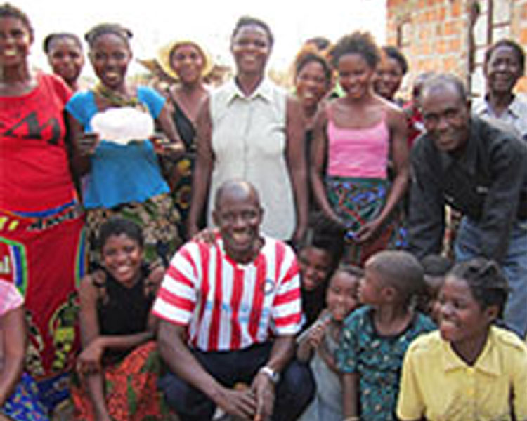Martin (bottom center) with his team and community members in Kamphelo, where the community and team worked together to create a disposable sanitary pad prototype.