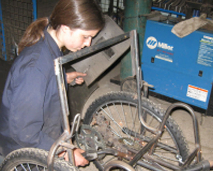 Welding the hand-cycle at APDK, Nairobi, Kenya.