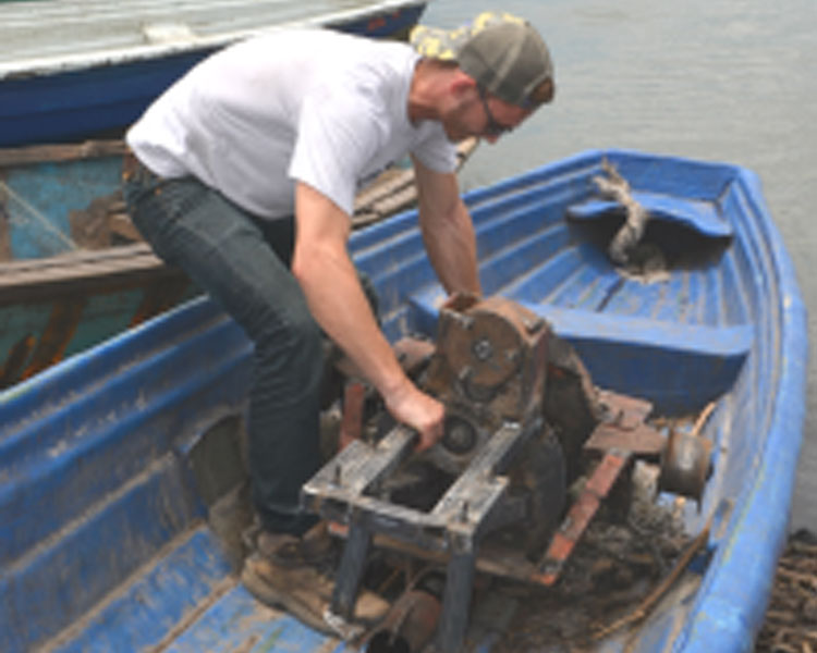 Loading the gearbox onto a boat.