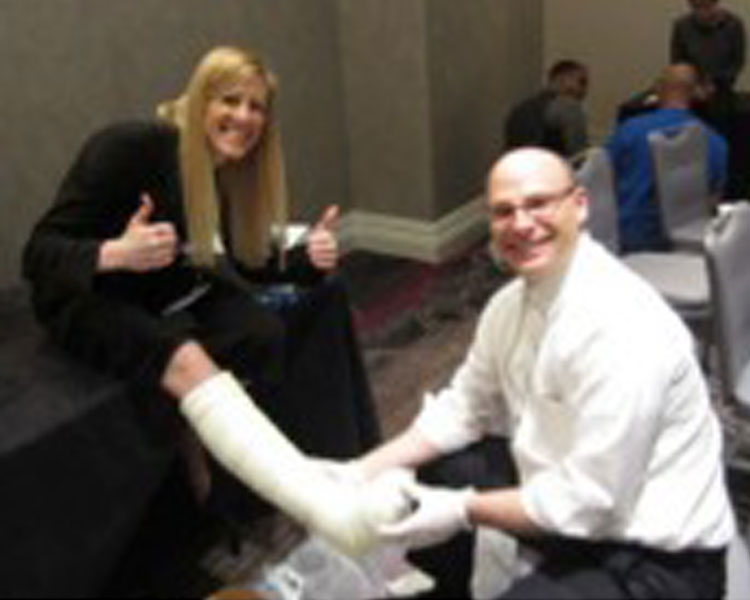 Danielle Zurovcik (left) and Jon Bloom, MD (right) learning about off-loading technologies at DFCon 2014.