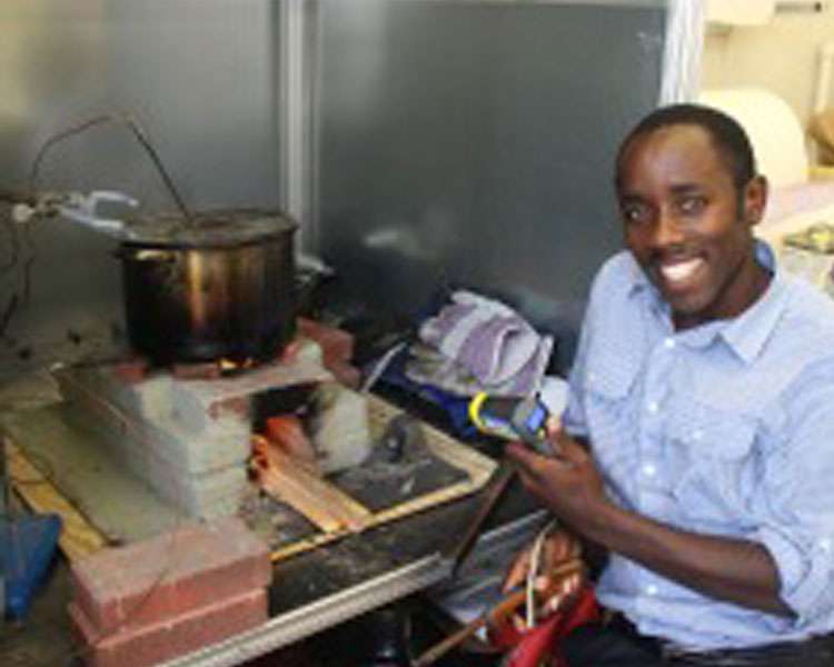 D-Lab Visiting practitioner Elius Muhimbise from Uganda evaluates his low-cost mud/brick wood stove