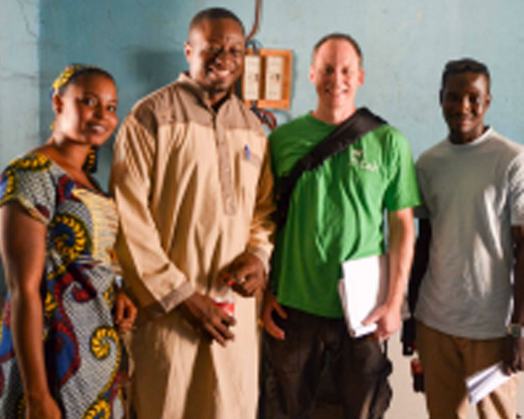 (l-r) A woman who works at a dairy co-operative, Sory Mariko (Mercy Corps), Eric Verploegen (D-Lab), and Abdoulaye Coulibaly (translator).