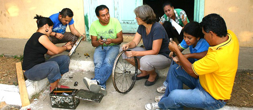 MIT D-Lab Founding Director Amy Smith (third from right) with inventor and Bici-Tec Founder Carlos Marroquin (third from left), working with members of a community in El Salvador.