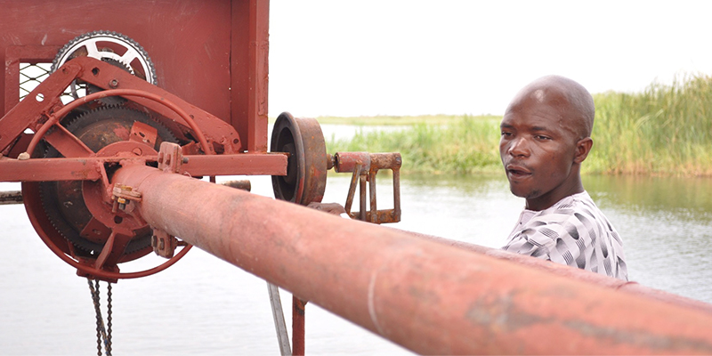 Robert Shimaingo, innovator from Kafue, Zambia, with a prototype of his underwater, dam-free turbine.