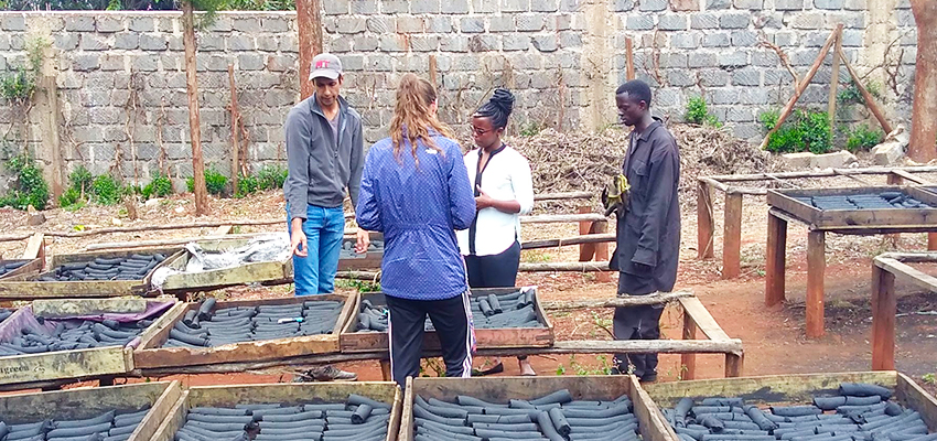 "MIT D-Lab trip leader and D-Lab: Energy I instructor Amit Gandhi and blog post author Danielle Gleason discuss sensors with Chebet Lesan, CEO of BrightGreen Renewable Energy, Kenya."" Photo by Jessica Huang."