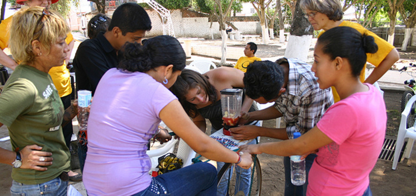 "D-Lab students and Amy Smith working on a ""bici-blender,"" El Salvador, 2013."