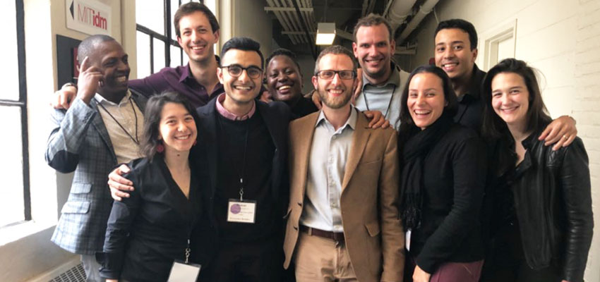 Nine Innovation Ecosystem Builder Fellows at MIT D-Lab — Building N51, Massachusetts Institute of Technology, flanked by the Innovation Ecosystems Manager.