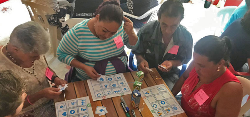 A Bingo game helps women identify benefits and challenges in their coffee and mining activities. Santa Rita, Colombia, January 2019.
