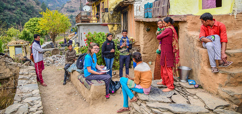 D-Lab students and mechancial engineering graduate student Krithika Ramchander conducting user-feedback interview for Xylem waterfilter prototypes, Uttarakhand, India. January 2018. Photo: Megha Hegde.
