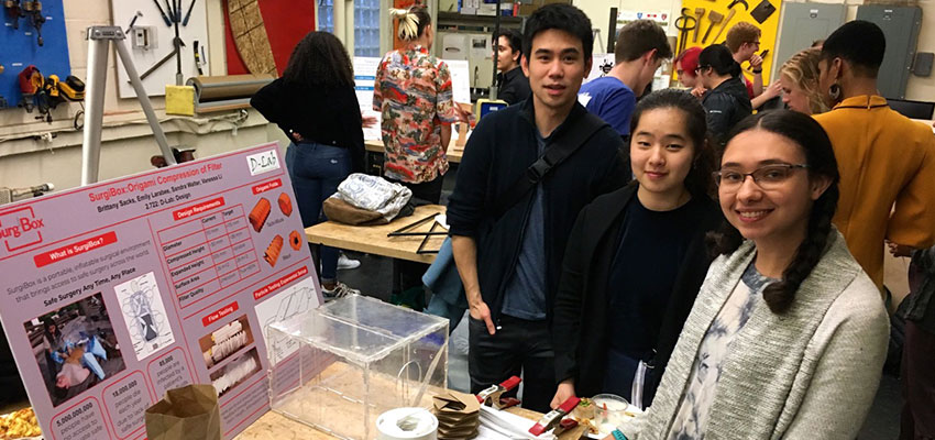 D-Lab: Design students and SurgiBox's Stephen Okajima (left) with the poster and project the students prepared.