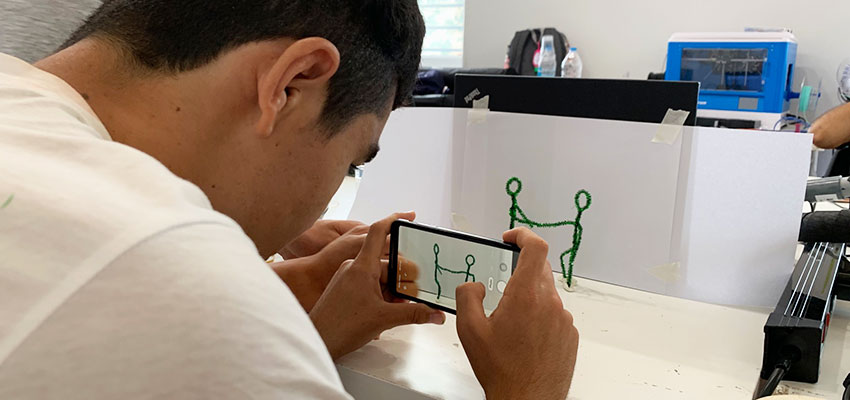An unaccompanied minor refugee works on creating a stop motion movie for the D-Lab Video Class at the Faros Horizon Boys' Center. Athens, Greece, Summer 2019. Photo: Susana Tort