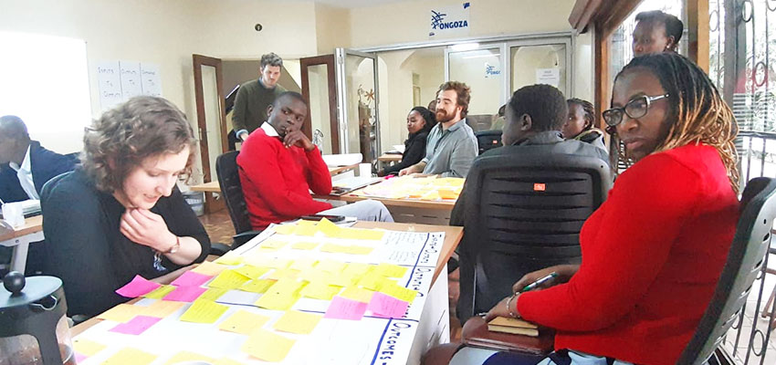 Conducting an all-staff Theory of Change workshop at Ongoza, using concentrated design sprints to rapidly generate the assumptions that can undercut desired impact. Photo: Taylor Light