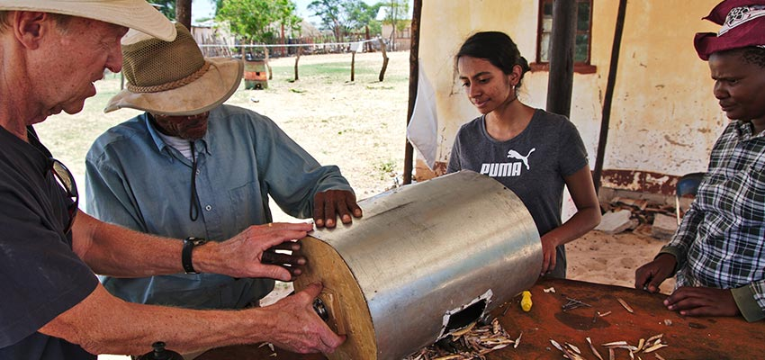 D-Lab Student and community members working on a bean thresher, Dutlwe, Botswana, in January of 2019.