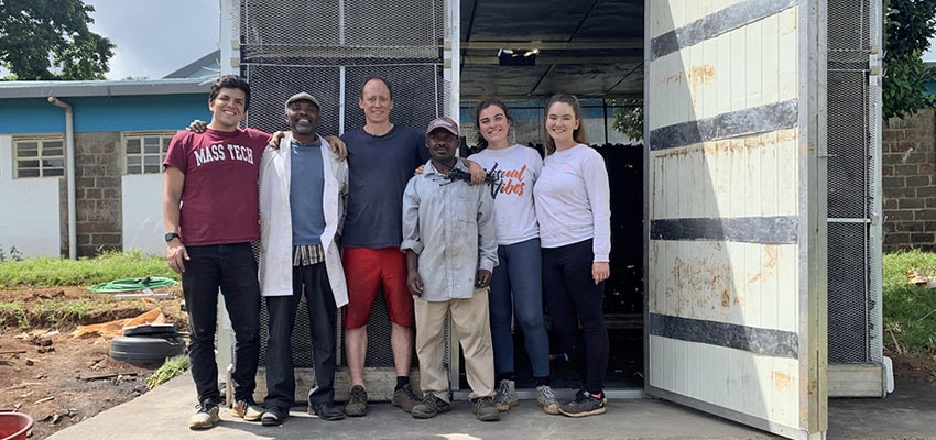 Left to right: Alex Encinas, MIT junior in mechanical engineering; Mwachoni El-Yahkim of the University of Nairobi; Eric Verploegen, research engineer at MIT D-Lab; Boniface Manambo of the University of Nairobi; Christine Padalino, MIT junior in chemical engineering; and Madeline Bundy, MIT senior in chemical engineering, stand in front of an evaporative cooling chamber they built at the University of Nairobi in Kenya. Credits: Photo courtesy of MIT D-Lab