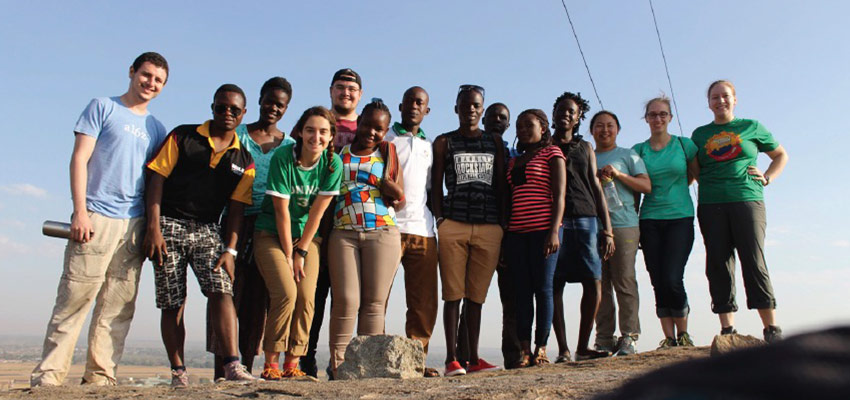 A team of MIT D-Lab and akerere University students, and TEWDI staff members, pose for a picture at the top of Soroti Rock. Photo: Lauren Bustamante
