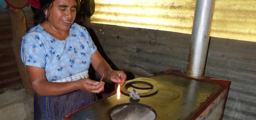 Woman lighting stove.