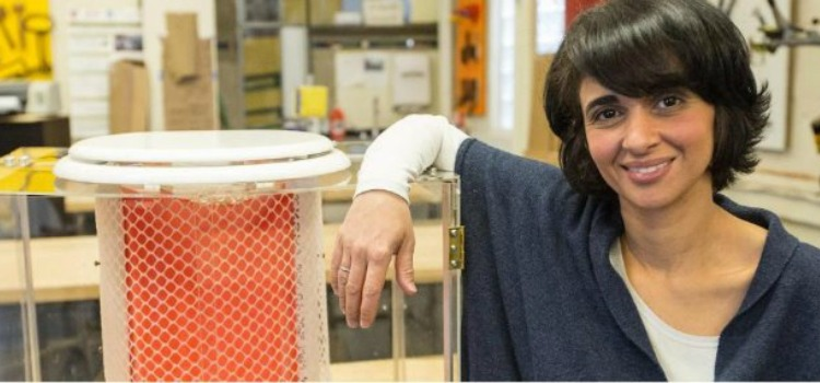 Diana Yusef in the D-Lab shot with a prototype of the ChangeWater Labs waterless toilet.