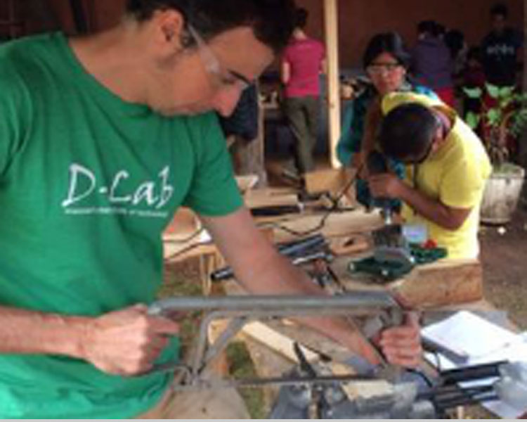 Victor demonstrating woodworking skills at a Creative Capacity Building workshop in Guatemala.