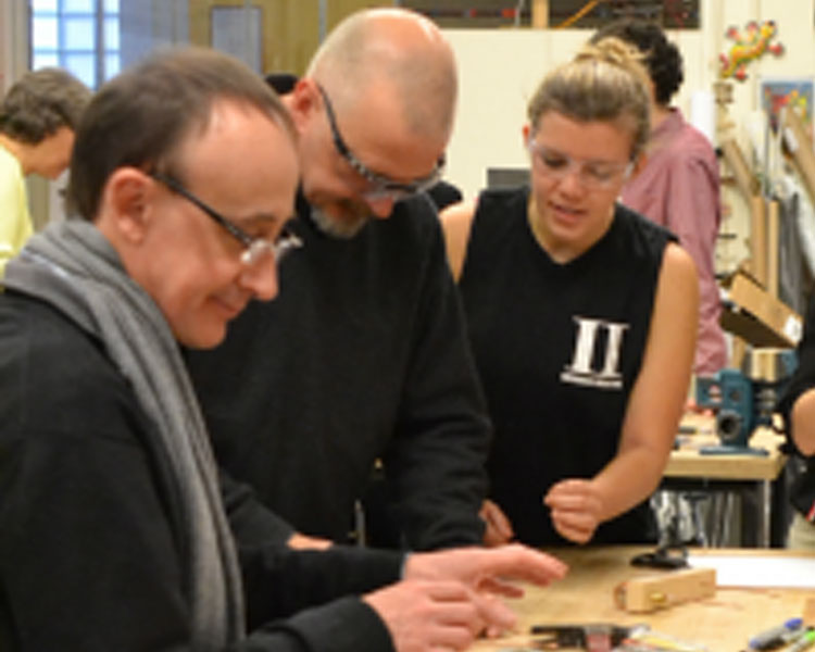 Thierry Delepoulle (Danone) and Michael Moscherosch (Johnson & Johnson) build a hot wire cutter with D-Lab student Rachael Aptowitz.