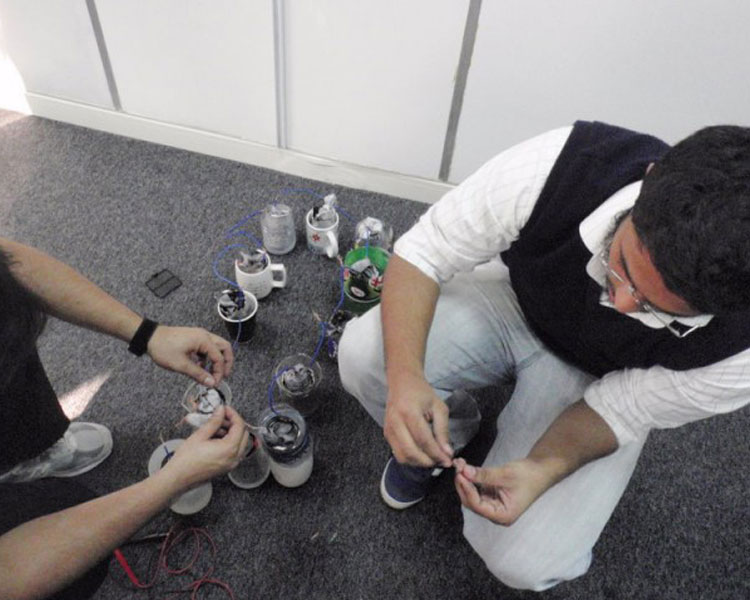 Syed and Ali connecting aluminum can batteries